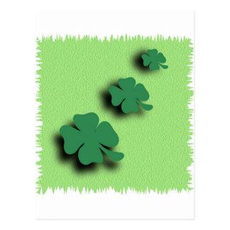 Trefoil symbol irish on the green background postcard