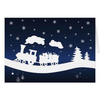 Tren del navidad con la tarjeta de nota de los reg