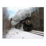 Tren del vapor en invierno postal
