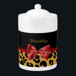 """Trendy Black and Gold Leopard Print Red Ribbon Bow Teapot<br><div class=""""desc"""">A trendy black and gold leopard print pattern pot with a cute red ribbon bow wrapped like a present. Personalize by adding your name. Perfect present for the chic and elegant woman!</div>"""