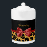 "Trendy Black and Gold Leopard Print Red Ribbon Bow Teapot<br><div class=""desc"">A trendy black and gold leopard print pattern pot with a cute red ribbon bow wrapped like a present. Personalize by adding your name. Perfect present for the chic and elegant woman!</div>"