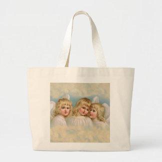 Tres ángeles en un cielo en colores pastel bolsa tela grande