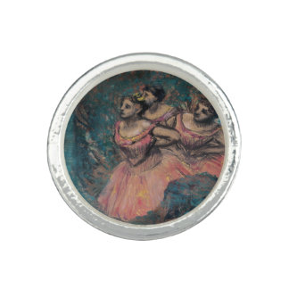 Tres bailarines en traje rojo de Edgar Degas
