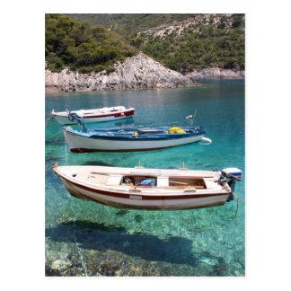 Tres barcos de pesca postal