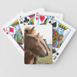Tres caballos en naipes de una fila barajas de cartas