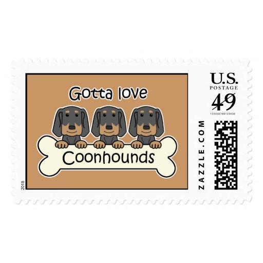 Tres Coonhounds negros y del moreno Franqueo