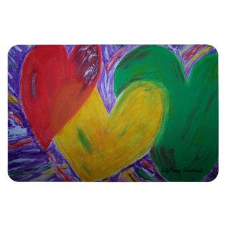 Tres corazones junto imanes rectangulares