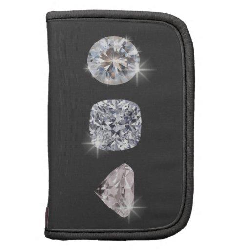 Tres diamantes brillantes cristalinos planificador