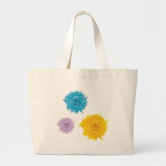 Tres floraciones coloridas bolsas lienzo