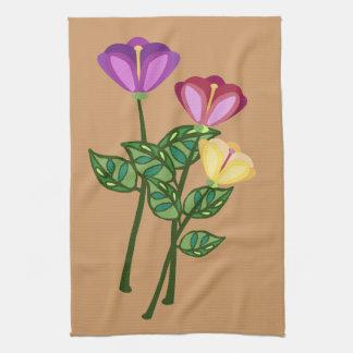 tres flores elegantes en troncos largos toallas