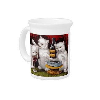 Tres gatitos alegres jarras de beber