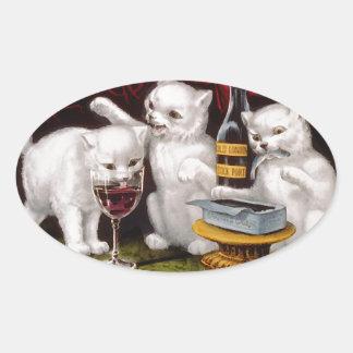 Tres gatitos alegres pegatina ovalada