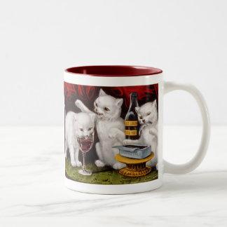 Tres gatitos alegres taza de dos tonos