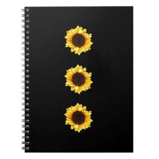 Tres girasoles soleados cuadernos
