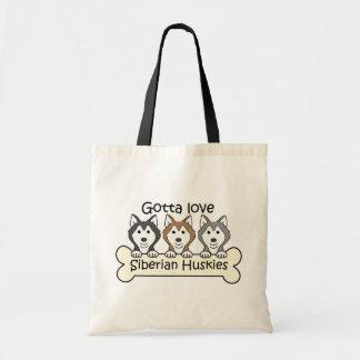Tres huskyes siberianos bolsas de mano