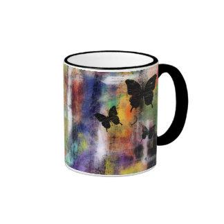Tres mariposas tazas de café