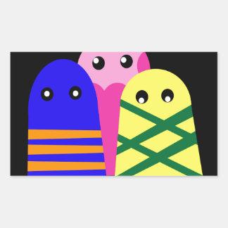 Tres monstruos lindos pegatina rectangular