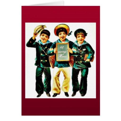 Tres muchachos y los muchachos uno llevan a cabo l felicitaciones