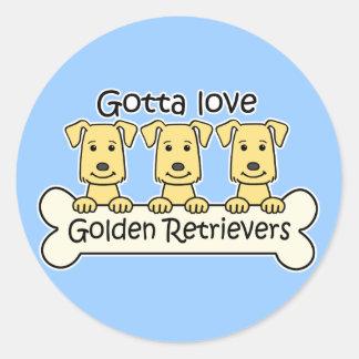 Tres perros perdigueros de oro pegatina redonda