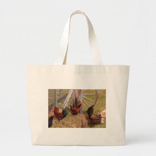 Tres pollos y un gato bolsa de mano