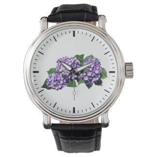Tres racimos púrpuras del Hydrangea Reloj