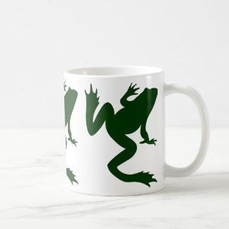 Tres siluetas verde oscuro de la rana de las ranas taza de café