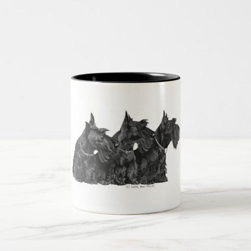 Tres terrieres escoceses curiosos taza