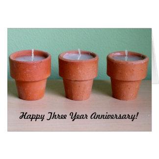 Tres velas votivas en potes de arcilla tarjetas