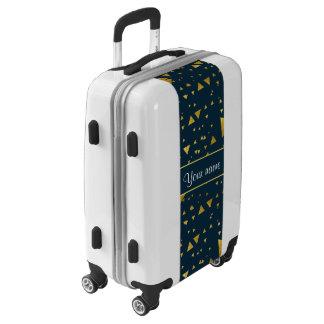 Triángulos contemporáneos del oro en azules maletas