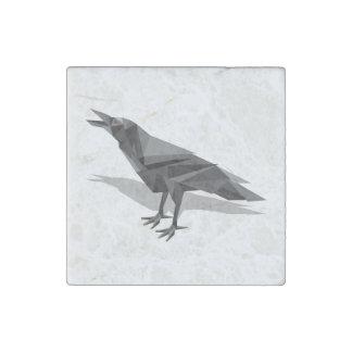 Triángulos grises cubistas geométricos del cuervo imán de piedra