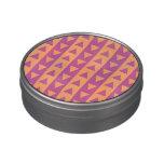 Triángulos y rayas púrpuras y anaranjados latas de caramelos