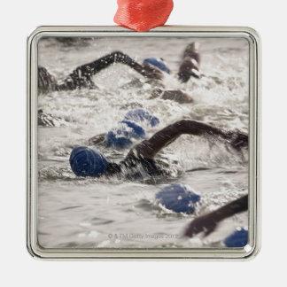 Triathletes competing in swim leg of triathlon. metal ornament