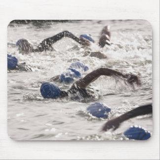 Triathletes competing in swim leg of triathlon. mouse pad