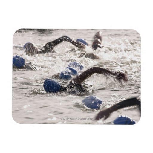 Triathletes competing in swim leg of triathlon. rectangular photo magnet