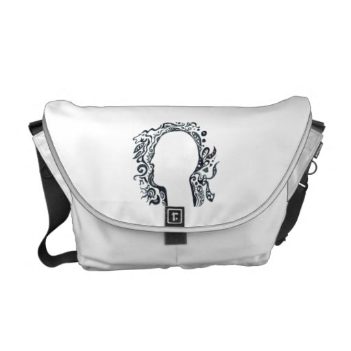 Tribal design silhouette head courier bag