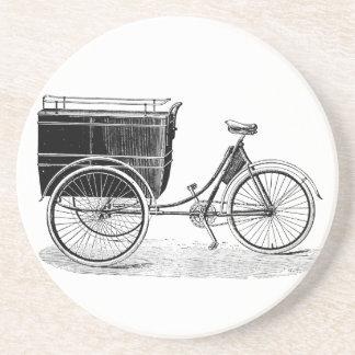 Triciclo antiguo del vintage posavasos cerveza