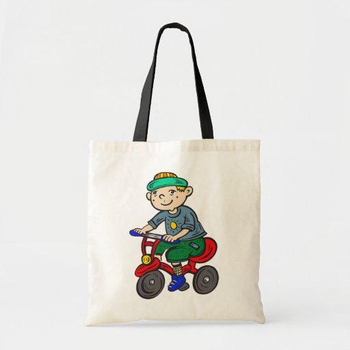 Triciclo del montar a caballo del muchacho bolsas