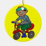 Triciclo del montar a caballo del muchacho adorno de navidad