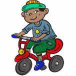 Triciclo del montar a caballo del muchacho escultura fotográfica