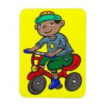 Triciclo del montar a caballo del muchacho imanes