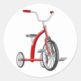 Triciclo rojo realista etiqueta redonda