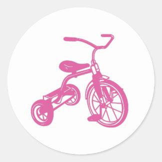 Triciclo rosado pegatina redonda