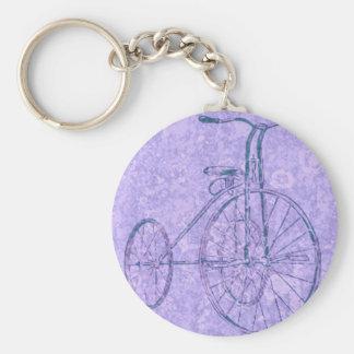 triciclo violeta llaveros