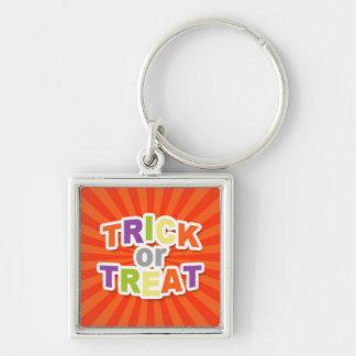 Trick or Treat on Orange Starburst.jpg Keychain