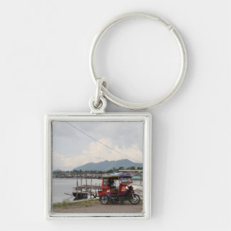Tricycle on a quay keychain