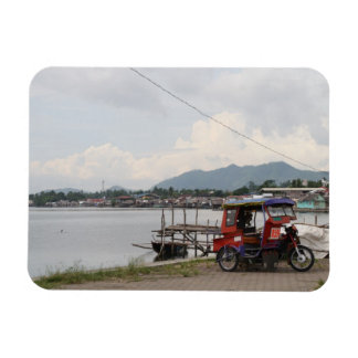 Tricycle on a quay magnet