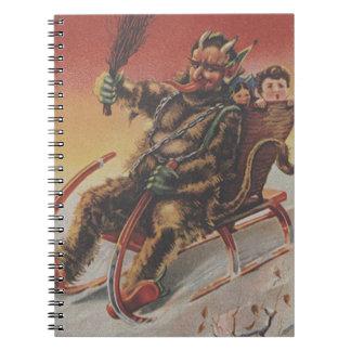 Trineo de los niños del secuestro de Krampus Spiral Notebook