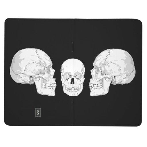 Trío del cráneo cuadernos grapados