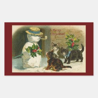 Trío del gatito con el muñeco de nieve y el acebo rectangular pegatinas