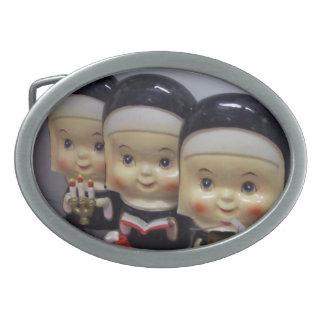 Trio Of Nuns Oval Belt Buckles